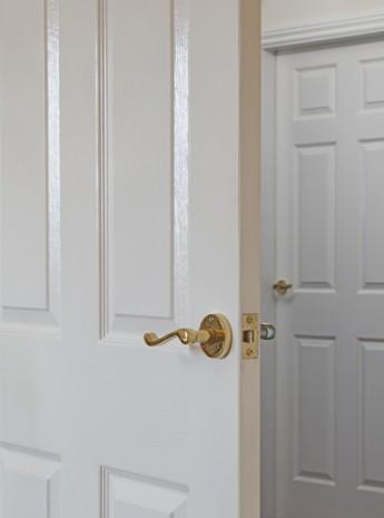 Handle on a white door