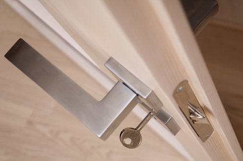 Handles for doors with locks